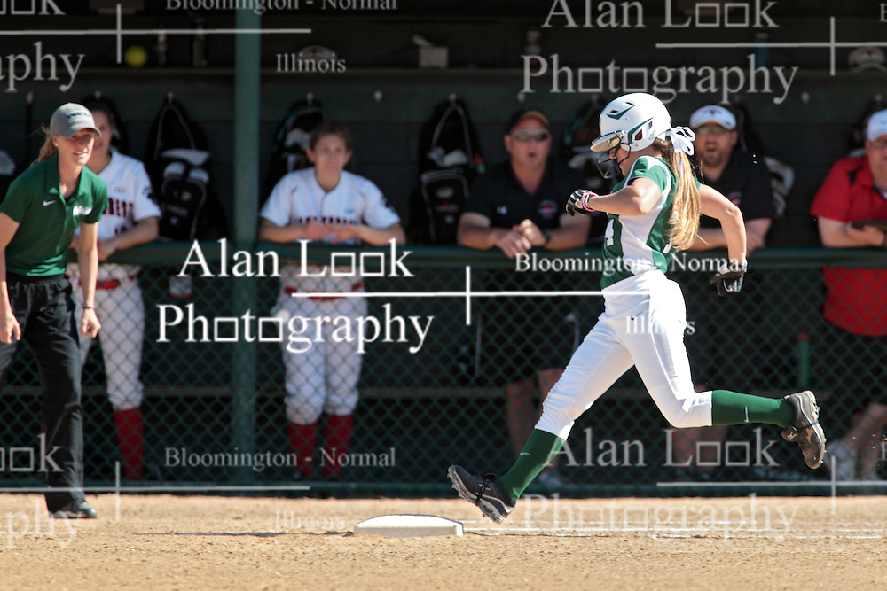 09 May 2014:  Kyley McKeown runs to first to beat out a bunt during an NCAA Division III women's softball championship series game between the Lake Forest Foresters and the Illinois Wesleyan Titans in Bloomington IL