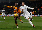 Ola Aina of Hull City clears from Pierre-Michel Lasogga of Leeds United during the EFL Sky Bet Championship match between Hull City and Leeds United at the KCOM Stadium, Kingston upon Hull, England on 30 January 2018. Photo by Paul Thompson.
