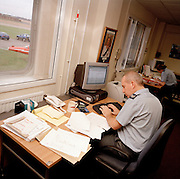 Administrative personnel of the Red Arrows, Britain's RAF aerobatic team, perform clerical duties.