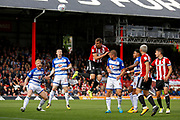 Brentford Defender Andreas Bjelland (5) heads on goal during the EFL Sky Bet Championship match between Brentford and Reading at Griffin Park, London, England on 16 September 2017. Photo by Andy Walter.
