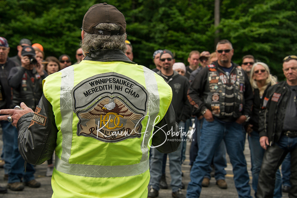 """Ron Egalka president of the Winnipesaukee Meredith NH Chapter of Harley Davidson owners greets fellow riders Thursday morning for their annual """"Ride to the Sky"""" from Laconia Harley in Meredith.  (Karen Bobotas/for the Laconia Daily Sun)"""
