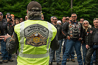 "Ron Egalka president of the Winnipesaukee Meredith NH Chapter of Harley Davidson owners greets fellow riders Thursday morning for their annual ""Ride to the Sky"" from Laconia Harley in Meredith.  (Karen Bobotas/for the Laconia Daily Sun)"
