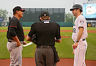 Kernels manager Jake Mauer (right) talks with River Bandits manager Omar Lopez before the start of a game between the Cedar Rapids Kernels and the Quad Cities River Bandits at Veterans Memorial Stadium in Cedar Rapids, Iowa on June 5, 2013.
