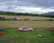 Volvo 240..A Volvo 240 car is parked in a field.