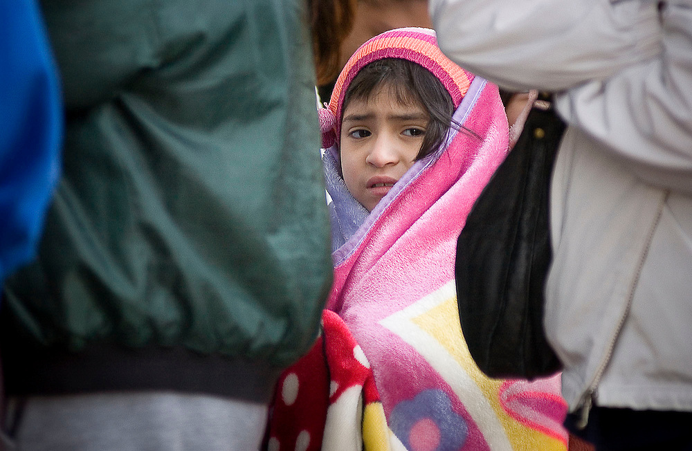 Yesenia Sandoval 7 of Tyler stands wrapped in a blanket in the line to get a coat through the PATH Coats for Kids program outside of the Discovery Science Place on Saturday, November 15, 2008. PATH, People Attempting To Help, is distributing coats to Smith County children through its PATH Coats for Kids program on Saturday from 7:30AM - 2:00 PM and on Sunday from 100:PM -5:00 PM or until all of the coats are gone.