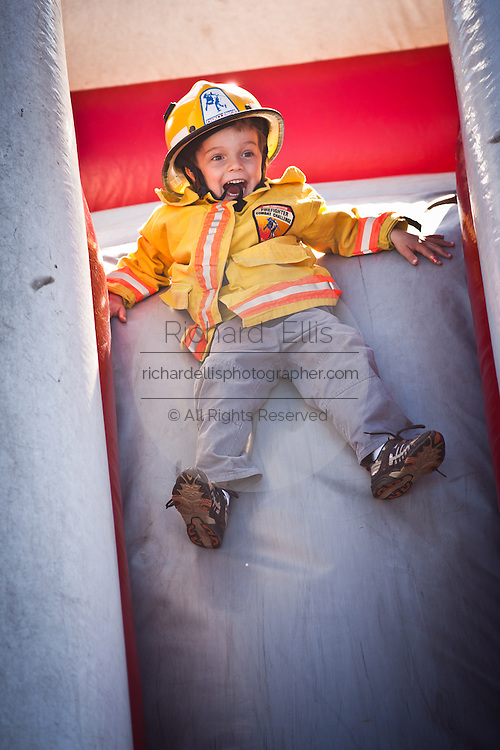 A young boy plays in a childrens obstacle course as adults compete next door at the international finals of the Firefighter Combat Challenge on November 18, 2011 in Myrtle Beach, South Carolina.  )