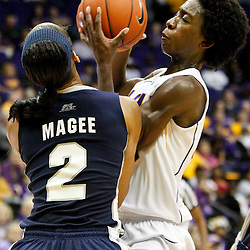 November 16, 2011; Baton Rouge, LA; LSU Tigers guard Destini Hughes (20) draws a foul from Georgetown Hoyas forward Tia Magee (2) during the first half of a game at the Pete Maravich Assembly Center.  Mandatory Credit: Derick E. Hingle-US PRESSWIRE