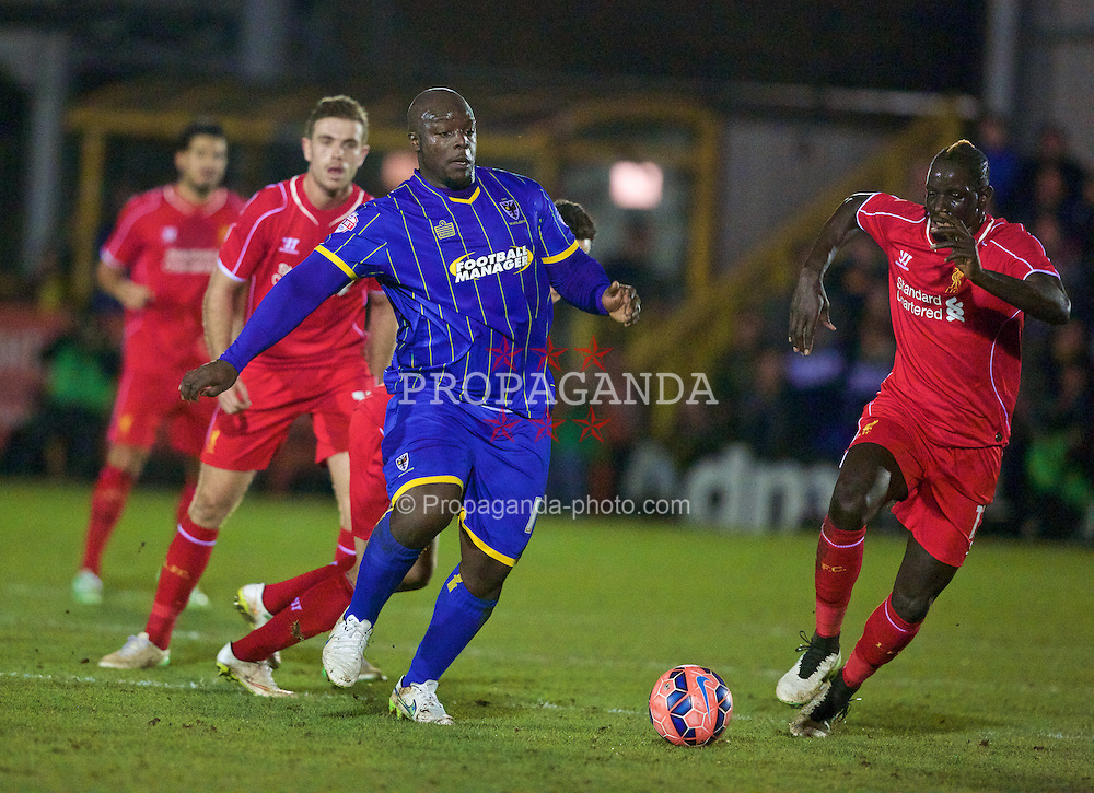 KINGSTON-UPON-THAMES, ENGLAND - Monday, January 5, 2015: AFC Wimbledon's Adebayo Akinfenwa in action against Liverpool during the FA Cup 3rd Round match at the Kingsmeadow Stadium. (Pic by David Rawcliffe/Propaganda)