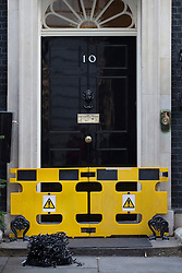 © licensed to London News Pictures. London, UK 30/11/2012. Number 10 blocked temporarily as the Downing Street Christmas Tree being erected on 30/11/12. Photo credit: Tolga Akmen/LNP