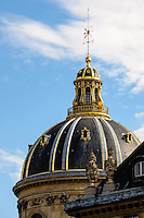 Paris, France. View from a boat on the river Seine. The dome of The Institut de France.