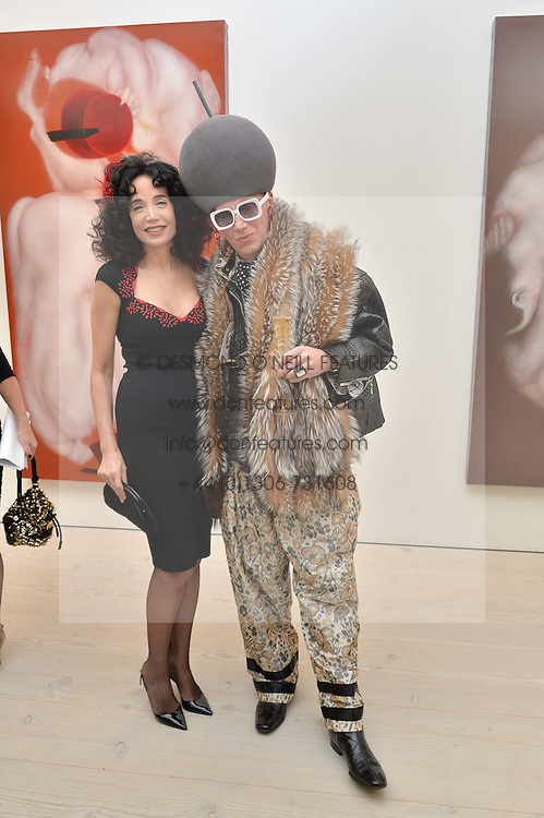 Artist MOUNA REBEIZ and BERNHARD HOFSTETTER at the launch of a new exhibition 'Le Tarbouche' by French-Lebanese artist Mouna Rebeiz held at The Saatchi Gallery, Duke of York's HQ, King's Road, London on 26th February 2015.