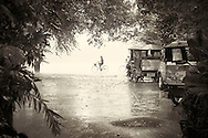 bike rider in rain Siem Reap Cambodia