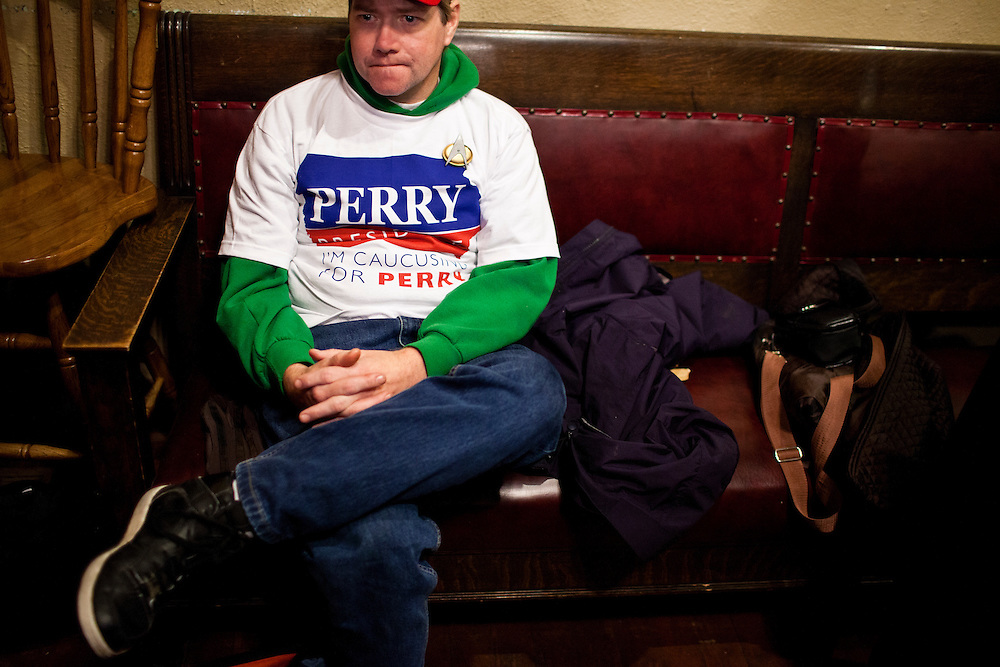 A supporter of Republican presidential candidate Rick Perry listens as the candidate speaks at Kuhly's Bar & Grill on Thursday, December 22, 2011 in Ottumwa, IA.