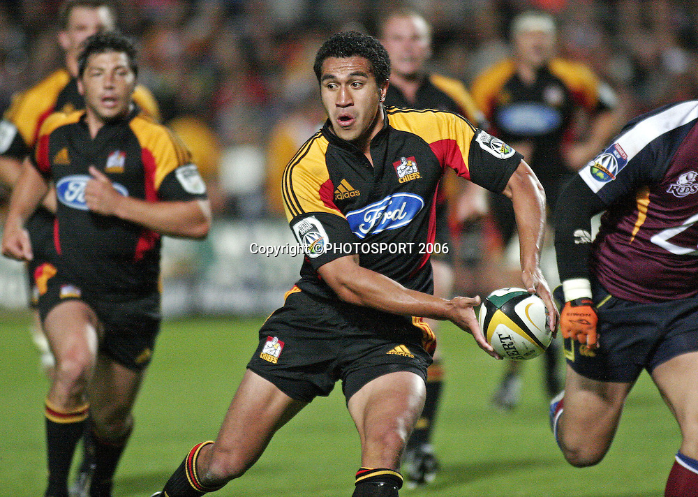 Chiefs fullback Mils Muliaina looks to offload the ball during the Super 14 match between the Waikato Chiefs and Queensland Reds at Waikato Stadium, Hamilton on Friday 3 March 2006. The Chiefs won the game 35:17. Photo: Andy Song/PHOTOSPORT