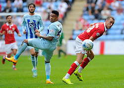 Bristol City's Aaron Wilbraham battles for the high ball with Coventry City's Jordan Willis  - Photo mandatory by-line: Joe Meredith/JMP - Mobile: 07966 386802 - 18/10/2014 - SPORT - Football - Coventry - Ricoh Arena - Bristol City v Coventry City - Sky Bet League One