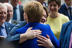 © Licensed to London News Pictures. 12/06/2017. London, UK. SNP leader NICOLA STURGEON is hugged before a photocall and press conference outside parliament with Nicola Sturgeon and the SNP newly elected MPs. Over the weekend British prime minister Theresa May formed a new cabinet and continues discussions with the DUP in an attempt to form a new government. Photo credit: Ben Cawthra/LNP