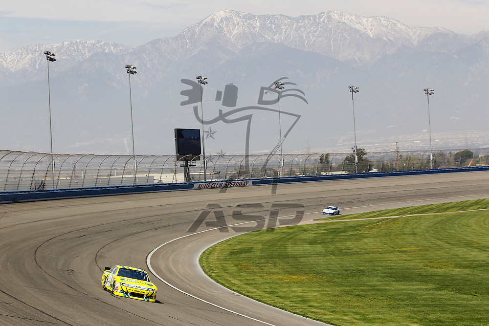 FONTANA, CA - MAR 23, 2012:  Carl Edwards (99) brings his car through turn 4 during the Auto Club 400 at the Auto Club Speedway in Fontana, CA.