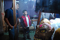 """MEXICO, Veracruz, Tantoyuca, Oct 27- Nov 4, 2009. Mask shopping in Tantoyuca's """"Plaza Constitucion."""" """"Xantolo,"""" the Nahuatl word for """"Santos,"""" or holy, marks a week-long period during which the whole Huasteca region of northern Veracruz state prepares for """"Dia de los Muertos,"""" the Day of the Dead. For children on the nights of October 31st and adults on November 1st, there is costumed dancing in the streets, and a carnival atmosphere, while Mexican families also honor the yearly return of the souls of their relatives at home and in the graveyards, with flower-bedecked altars and the foods their loved ones preferred in life. Photographs for HOY by Jay Dunn."""