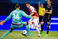 Francis Coquelin #34 of Arsenal F.C., Mesut Ozil #11 of Arsenal F.C. and Josip Pivaric #19 of GNK Dinamo Zagreb during football match between GNK Dinamo Zagreb, CRO and Arsenal FC, ENG in Group F of Group Stage of UEFA Champions League 2015/16, on September 16, 2015 in Stadium Maksimir, Zagreb, Croatia. Photo by Urban Urbanc / Sportida