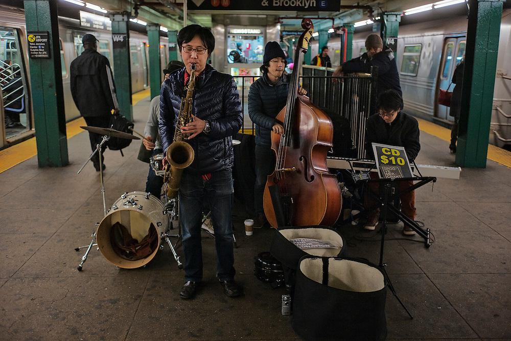 Jazz band playing on West 4th St subway platform, New York, NY, US