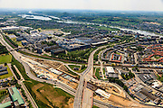 Nederland, Limburg, Maastricht, 27-05-2013; bouwwerkzaamheden voor de A2 traverse, De Groene Loper. <br /> Tunnelbouwkuip Europaplein. Maastrichts Expositie & Congres Centrum (MECC) en Academisch Ziekenhuis Maastricht (AZM) in de achtergrond, de Maas en Sint Pietrberg aan de horizon.<br /> De snelweg A2 gaat ondergronds, er wordt een gestapelde tunnel gebouwd (2 wegen boven elkaar). Het plan moet voor een betere bereikbaarheid en leefbaarheid van Maastricht zorgen en ook voor een betere doorstroming op de A2.<br /> Construction works for motorway A2 crossing Maastricht, the so-called Green Carpet.<br /> The A2 motorway goes underground, a stacked tunnel is  built with two roads above each other). The plan should provide better accessibility and traffic flow.<br /> luchtfoto (toeslag op standard tarieven);<br /> aerial photo (additional fee required);<br /> copyright foto/photo Siebe Swart.