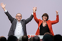 06 DEC 2019, BERLIN/GERMANY:<br /> Norbert Walter-Borjans (R), SPD, Minister a.D., Kandidat fur das Amt des Parteivorsitzenden, Saskia Esken (L), MdB, SPD, Kandidatin fuer das Amt der Parteivorsitzenden, nach ihren Bewerbungsreden und vor der Wahl der Parteivorsitzenden, SPD Bundesprateitag, CityCube<br /> IMAGE: 20191206-01-064<br /> KEYYWORDS: Party Congress, Parteitag, klatschen, applaudieren, Applaus