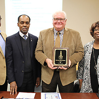 Aberdeen School Board members, from left, Patrick Lockett, Rodger Scott, Jim Edwards and Sandra Peoples pose for a photo after receiving the district's Mississippi School Boards Association Lighthouse School Leader Torch Award plaque. Not pictured is school board member Tonny Oliver.