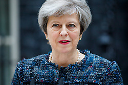 © Licensed to London News Pictures. 03/05/2017. London, UK. British Prime Minister THERESA MAY delivers a statement outside Downing Street in London after a meeting with The Queen to dissolve parliament ahead of an election on June 8. Photo credit: Tolga Akmen/LNP