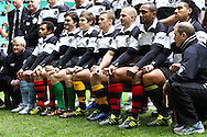 Matt Giteau (centre) with the Barbarians before the match between between the Barbarians and South Africa at Twickenham, London, on Saturday 4th December 2010. Traditionally, the Barbarians wear the socks of their home clubs. (Photo by Andrew Tobin/SLIK images)