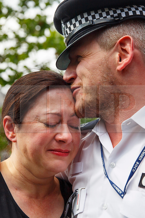 © Licensed to London News Pictures. 06/07/2015. London, UK. 7/7 survivor Gill Hicks and Constable Andy Maxwell reflecting outside King's Cross station to commemorate the 10th anniversary of 7/7 bombing on Monday, 6 July 2015. After the commemoration, Gill Hicks, who lost her legs at the 7 July 2005 London bombings on London Underground walked to Tavistock Square with faith leaders to remember those who lost their lives, as well as offering a message of peace and unity between people of different faiths and backgrounds. Photo credit: Tolga Akmen/LNP