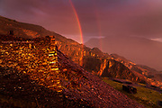 Stunning rainbows formed behind me as late evening sunset burned through sheets of rain moving across the mountains. It was so tempting to concentrate on the back-lit rain in front of me, but when this was going on behind my back I couldn't resist a snap :-)