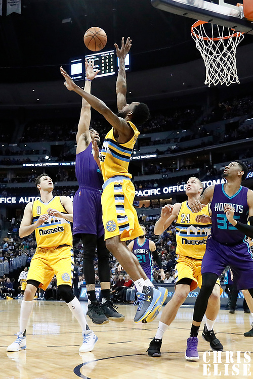 04 March 2017: Charlotte Hornets guard Jeremy Lamb (3) goes for the baby hook over Denver Nuggets guard Will Barton (5) during the Charlotte Hornets 112-102 victory over the Denver Nuggets, at the Pepsi Center, Denver, Colorado, USA.