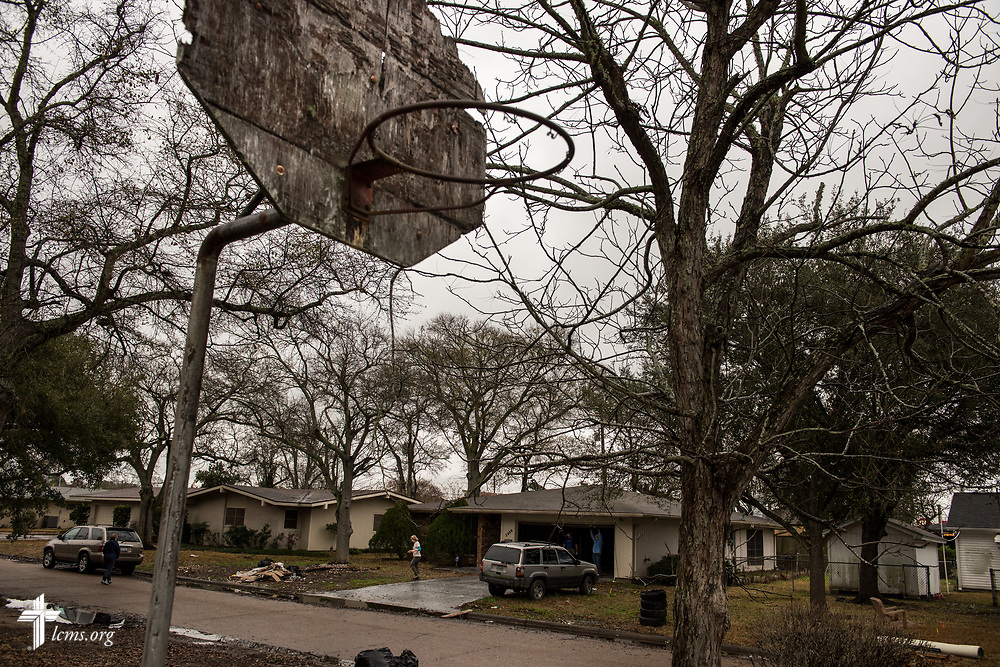 A volunteer exits a church member's home on Wednesday, Feb. 7, 2018, in Port Arthur, Texas. This particular neighborhood still had debris piles leftover from Hurricane Harvey, with owners living in trailers parked in front of their homes. Almost six months have passed since Hurricane Harvey devastated the area. LCMS Communications/Erik M. Lunsford
