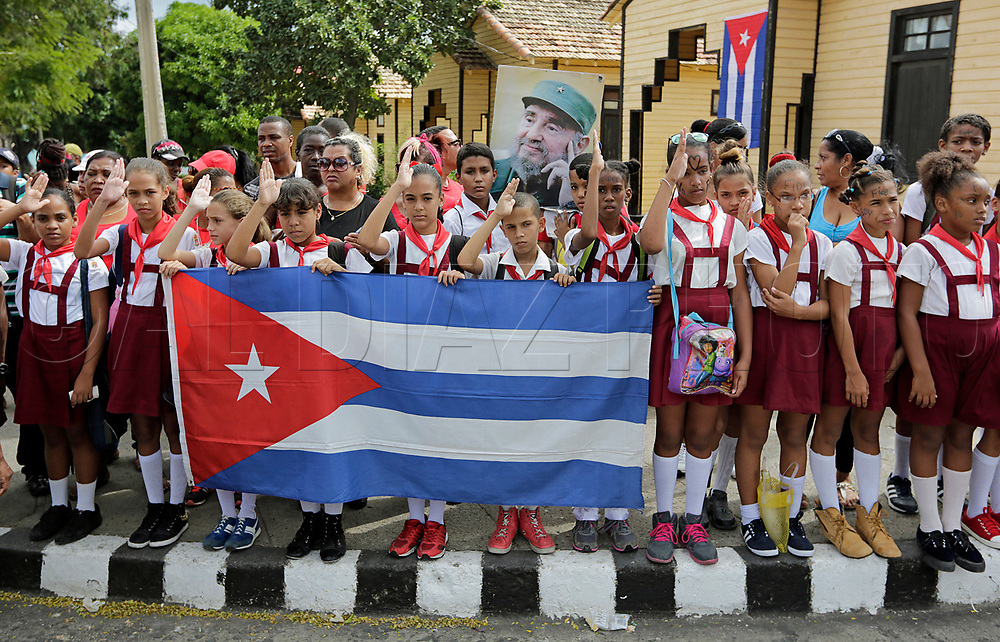 Cuban children salute as they wait for the passage of Fidel Castro's ashes outside the Moncada Barracks, in Santiago de Cuba on Saturday, December 3, 2016. <br /> On 26 July 1953, the barracks was the site of an armed attack by a small group of revolutionaries led by Fidel Castro. This armed attack is widely accepted as the beginning of the Cuban Revolution.