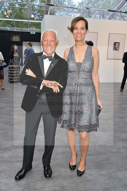 GIORGIO ARMANI and his niece ROBERTA ARMANI at British Vogue's Centenary Gala Dinner in Kensington Gardens, London on 23rd May 2016.