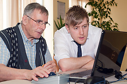 Digital Region Co-Running a series of workshops to equip the elderly with basic computer skills at Bakersfield Court sheltered housing on Longfellow Drive Rotherham Scott Castle with Derek Robertson..21 March 2011.Images © Paul David Drabble