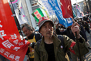 A left-wing Rally march against the exploitation of farmers during the construction of Narita Airport. Tokyo, Japan. Sunday March 23rd 2014. The main organiser of the protest was The Farmers' League Against Narita Airport. Around 1,000 activists from this league and other unions took part.