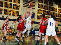 Gilford's Stevie Orton goes up for a shot against Moultonboro's Eleanor Eaton during first round game action during the 42nd annual Holiday Basketball Tournament at Gilford High School Monday evening.  (Karen Bobotas/for the Laconia Daily Sun)