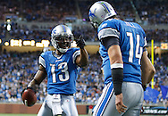 Detroit Lions wide receiver Nate Burleson (13) celebrates his touchdown with Detroit Lions quarterback Shaun Hill (14) in the second quarter of an NFL football game against the Minnesota Vikings in Detroit, Sunday , Jan. 2, 2011. (AP Photo/Rick Osentoski)
