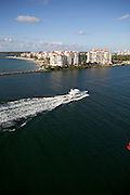 Aerial of yacht entering Government Cut, Miami, Florida, Fisher Island in the background