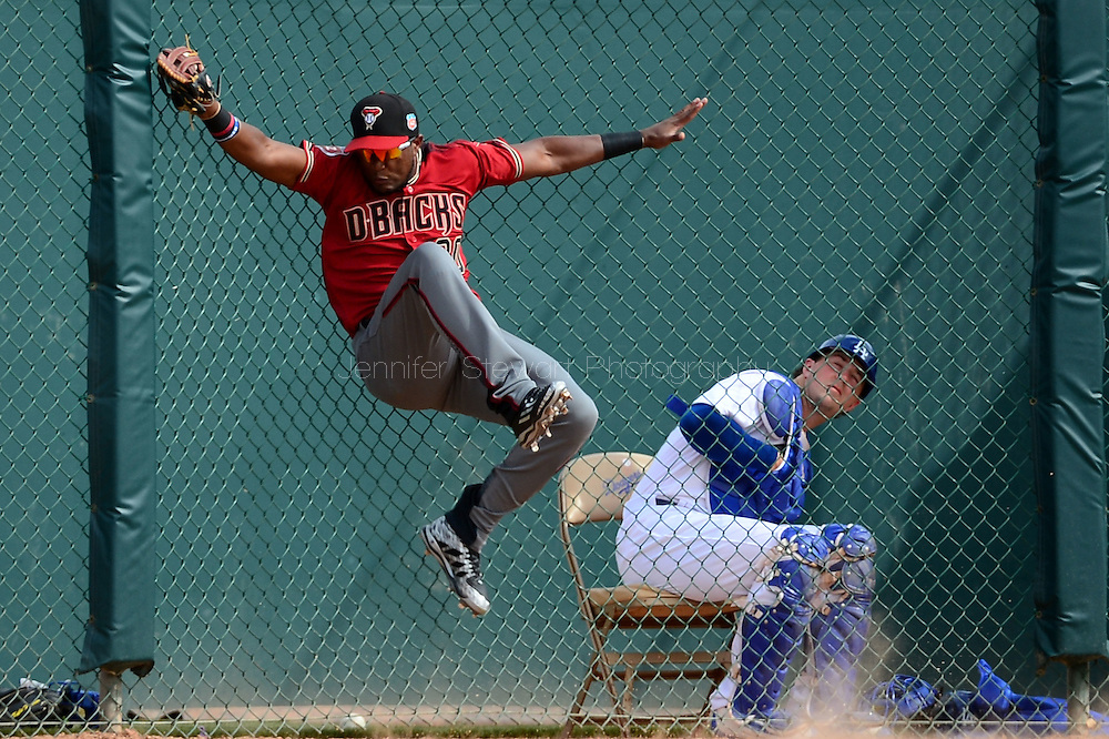 GLENDALE, AZ - MARCH 05:  Socrates Brito #30 of the Arizona Diamondbacks catches a fly ball in the fifth inning of the spring training game against the Los Angeles Dodgers at Camelback Ranch on March 5, 2016 in Glendale, Arizona.  (Photo by Jennifer Stewart/Getty Images) *** Local Caption *** Socrates Brito