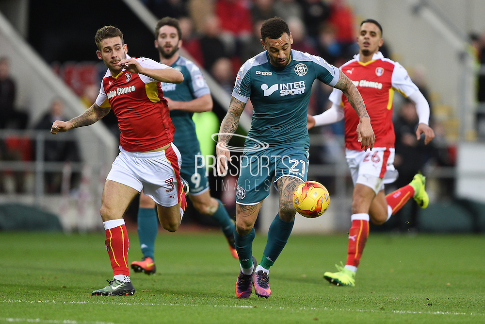 Wigan Athletic forward Craig Davies (21) on the attack during the EFL Sky Bet Championship match between Rotherham United and Wigan Athletic at the AESSAL New York Stadium, Rotherham, England on 26 December 2016. Photo by Jon Hobley.