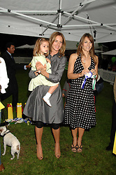 Left to right,  TRINNY WOODALL, her daughter LYLA ELICHAOFF and LIZ HURLEY at Macmillan Dog Day in aid of Macmillan Cancer Support, held at Royal Hospital Chelsea, London on 3rd July 2007.<br />