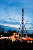 Families enjoy the Winter Wonderland at Hyde Park Corner, London England UK.