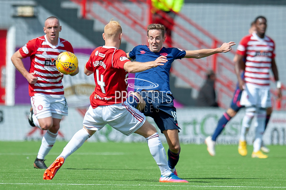 Steven MacLean of Heart of Midlothian flicks the ball past Ziggy Gordon of Hamilton Academical FC during the Ladbrokes Scottish Premiership League match between Hamilton Academical FC and Heart of Midlothian FC at New Douglas Park, Hamilton, Scotland on 4 August 2018. Picture by Malcolm Mackenzie.