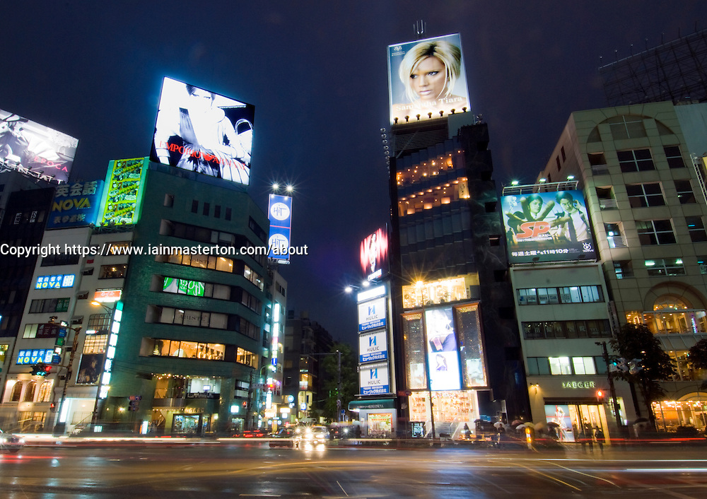 Night view of buildings and fashion billboards in fashionable Omotesando District of Tokyo Japan