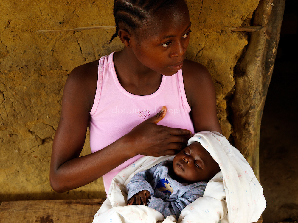 Jodephine, 16, with her new born baby, Garzon Reserve, Kingsville, Liberia.