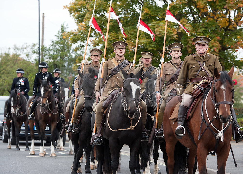© Licensed to London News Pictures. 23/10/2015. Bristol, UK. Enactment Lancers in World War One uniform on horseback parade through Bristol to launch the Bristol Poppy Appeal organised by the Royal British Legion. Relatives of Bristol Poppy seller Olive Cooke at an event outside Bristol Cathedral, organised by the Royal British Legion, received a ceramic poppy in memory of Olive from the Blood Swept Lands and Seas of Red exhibition. Photo credit : Simon Chapman/LNP