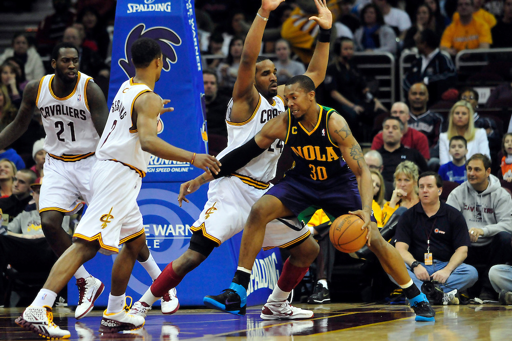 March 6, 2011; Cleveland, OH, USA; New Orleans Hornets power forward David West (30) drives the lane past Cleveland Cavaliers power forward Samardo Samuels (24) during the second quarter at Quicken Loans Arena. Mandatory Credit: Jason Miller-US PRESSWIRE