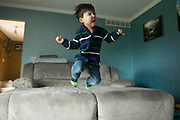 Victor Padilla, 3, jumps off the couch at his family's home in Rochester, New York on Monday, March 6, 2017. Victor has CLOVES Syndrome, a rare overgrowth syndrome diagnosed in only 200 people worldwide.
